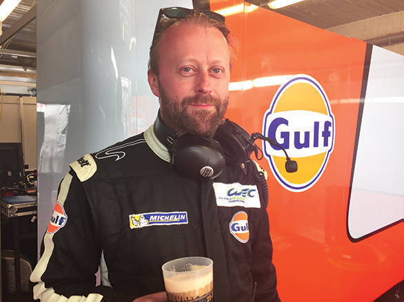 Owen Daley enjoys a much needed cold one after his team finished fifth in class at the 2016 24 Hours of Le Mans