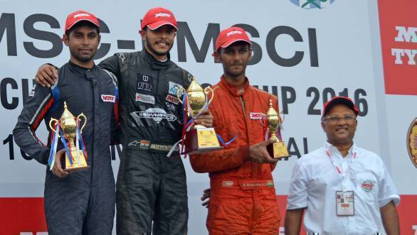 Vikash Anand, flanked by Anindith Reddy and Raghul Rangaswamy on the podium for Race 3 in the MRF 1600 class