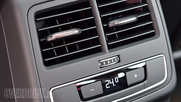 It features a three-zone climate control system