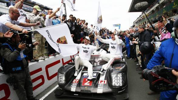 Romain Dumas, Marc Lieb and Neel Jani celebrate their victory at Le Mans
