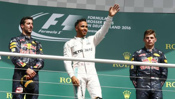 Victorious Lewis Hamilton on the podium at the 2016 German GP, flanked by Daniel Ricciardo and Max Verstappen