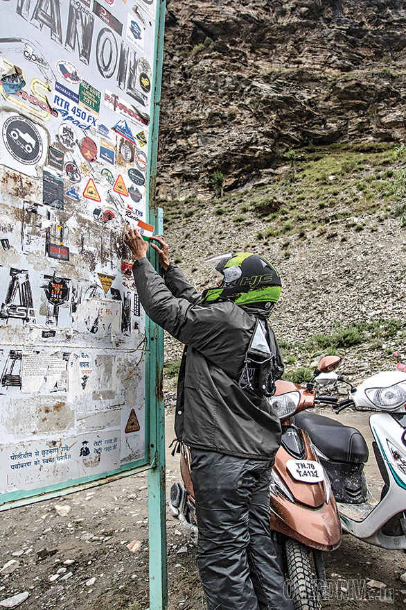 The sign board at Tandi, near Keylong, is supposed to proclaim a fuel station. What it has become is a sign post for travellers to leave their mark. Tandi is the last fuel station before Leh - a 365km run. Here, a TVS Himalayan Highs Season 2 participant, Trupti Sarmalkar, adds an Indian flag to mark the passage of the TVS Scooty Zest 110