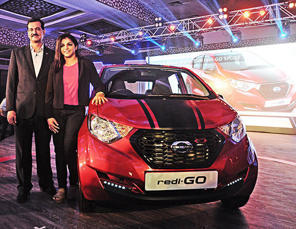 Arun Malhotra, MD Nissan Motor India PVT. LTD and Sakshi Malik  Olympic  medal winner at the Launch of limited edition Datsun redi-GO SPORT