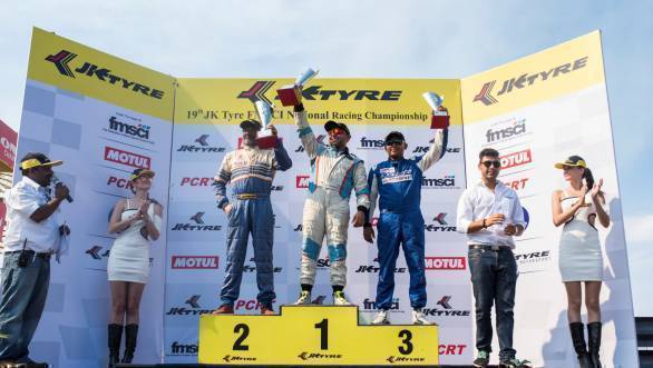 Ashish Ramaswamy flanked by Radha Selvarajan (left) and Deepak Chinnappa (right) celebrate their podium positions in the second JK Touring Car race of Round 3 at the Kari Motor Speedway