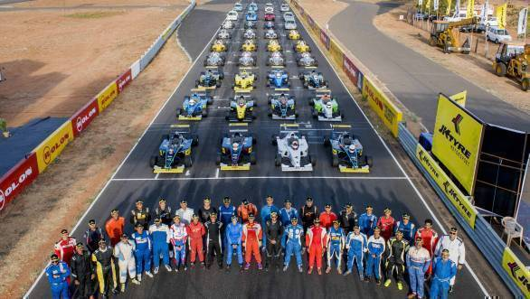 Full grid - JK Euro16, LGB Formula 4 and Indian Touring Car drivers with their machines in the background at Round 3 of the 2016 JK Racing Championship