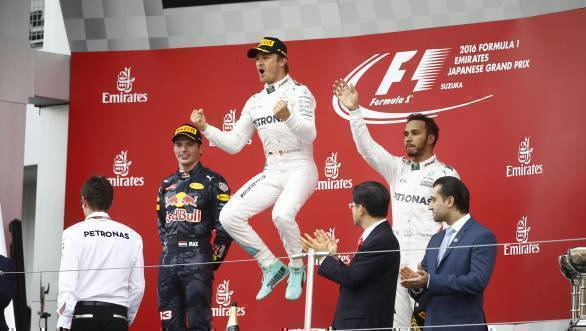 Nico Rosberg celebrates winning the 2016 Japanese Grand Prix, while second-placed Max Verstappen and third-placed Lewis Hamilton look on