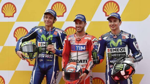 Ducati's Andrea Dovizioso, flanked by Yamaha riders Valentino Rossi and Jorge Lorenzo