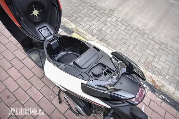 The narrow-skinny bodywork means the SR150 isn't a very practical scooter. The underseat storage is par for the course and if you have a reasonably good helmet, it's not going to fit in there. Note functional plastic filler cap.