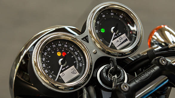 The T100 gets classic twin-pod clocks with analog readouts for road and engine speed