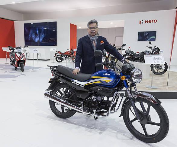 Image 1 - Mr. Pawan Munjal, CMD, Hero MotoCorp with Dawn 125 at EICMA 20...