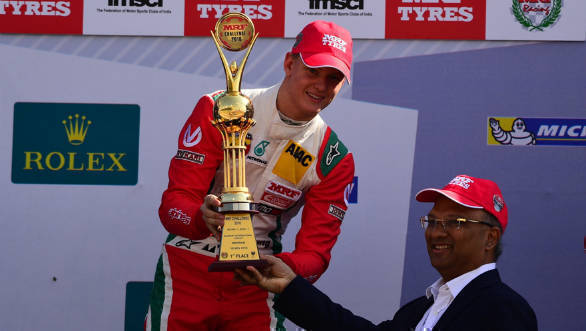 Mick Schumacher receiving the 1st place trophy from Mr