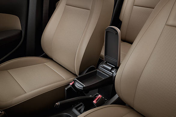The arm rest is adjustable and is carried over from the outgoing car