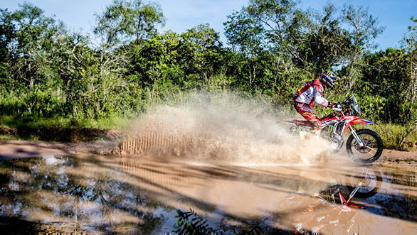 Team Honda Racing's Ricky Brabec makes his way through a water crossing on his Honda CRF 450 Rally