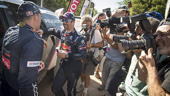 Sebastien Loeb and Stephane Peterhansel  of Team Peugeot TOTAL seen surrounded by media after stage 11 of Rally Dakar 2017 from San Juan to Rio Cuarto, Argentina on January 13, 2017. // Marc Bow/Red Bull Content Pool // P-20170113-01724 // Usage for editorial use only // Please go to www.redbullcontentpool.com for further information. //