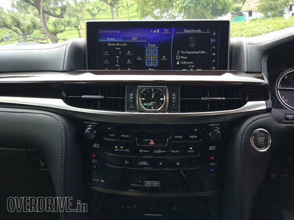 The interior design has quite an old school approach, but that's not a bad thing at all. The analogue clock and shape of the AC vents remind you of old school SUVs. The wood finish is impeccable. 19-speaker Mike Levinson belts out crisp and clear audio. One of the best we've experienced.