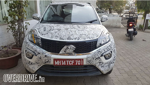 2017 Tata Nexon: The front features a a wide piano-finished grille