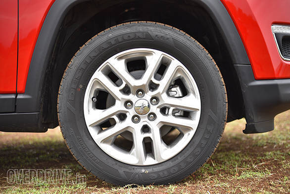 The 225/60 section tyres and the 17-inch wheels look a little small for the car