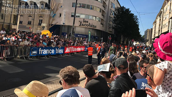 Massive crowd at the driver's parade at the centre of the city. Soon the drivers are going to come by and sign autographs, throw goodies into the crowd and make some fans quite happy!