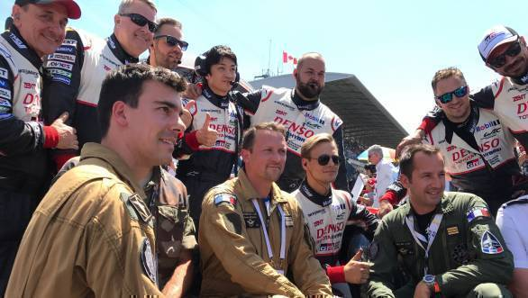 French air crew stopped by to pose with the Toyota crew. Men in uniform of different kinds at Le Mans