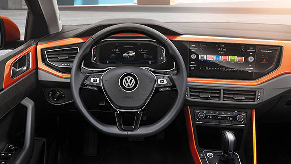 The steering wheel is a flat bottomed unit and houses the single button to access the meter console functions