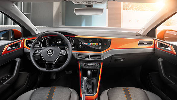 This is the R-Line trim and has orange accents to complement the exterior colour. The minimal button approach from the older car is continued here too