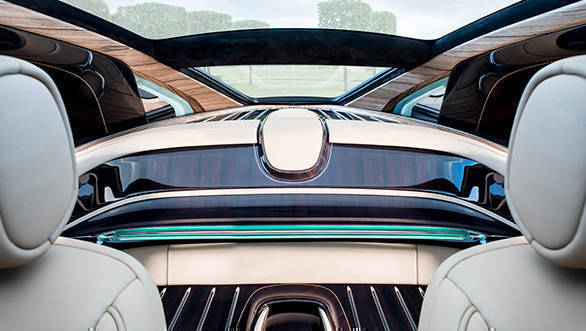 In place of the rear seats is a vast expanse of wood creating a mid-shelf with an illuminated glass lip, and a hat shelf