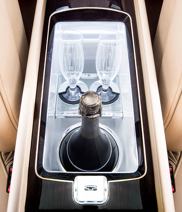 The entire centre console houses a mechanism that, at the touch of a button, deploys a bottle of the client's favourite champagne and two crystal champagne flutes