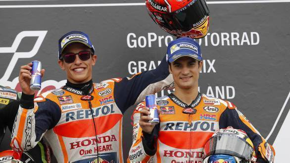 Marc Marquez celebrates on the podium with team-mate Dani Pedrosa who finished third at Sachsenring