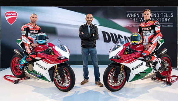Claudio Domenicalli, CEO, Ducati posing with Marco Melandri (left) and  Chaz Davies (right), WSBK riders