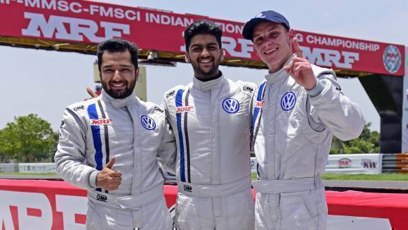 Race 2 winner, Dhruv Mohite, flanked by Karminder Pal Singh and South African guest driver Devin Robertson