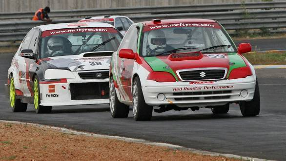 The battle for the lead in Race 1 of the ITC, with Ramaswamy's Red Rooster Racing car leading the pack