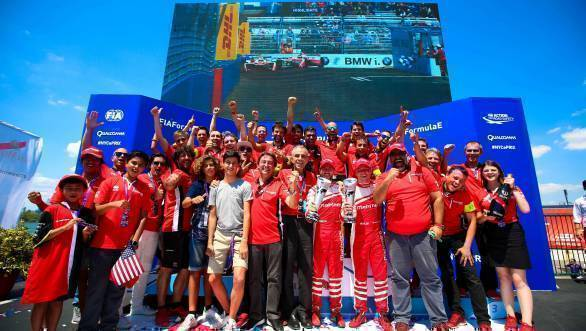The Mahindra Racing team celebrates their double podium finish at the second race of the NYC ePrix