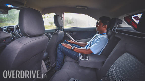 The sloping roofline doesn't eat space at the back. In fact, the packaging is very clever and Tata has used thin foam for the seats to liberate more space inside the cabin. Here is 5ft 7inch tall Anis sitting behind the driver's seat set for a 6ft plus driver