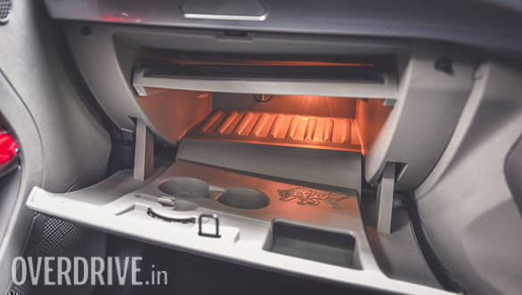 That glove box is big enough to hold a laptop (notice a separate compartment for it and is illuminated too). The tray can be removed to increase the storage capacity. The glovebox is cooled too