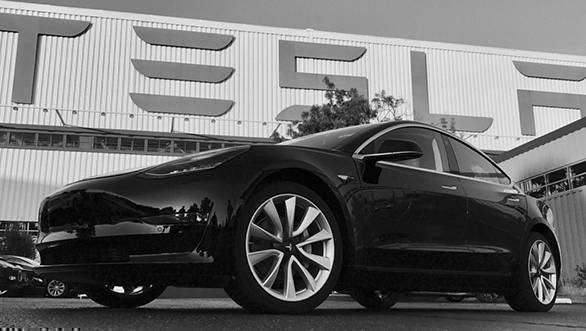 Elon Musk unveils the production-spec Tesla Model 3