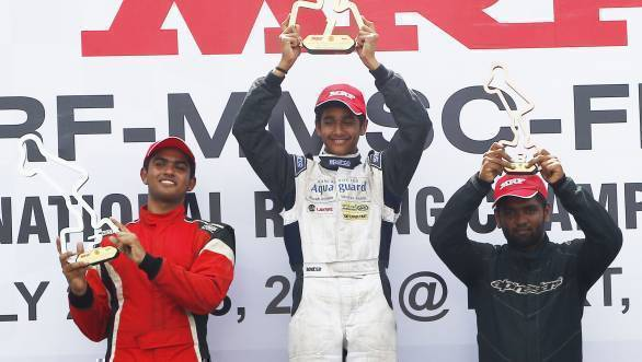 Yash Aradhya (centre), winner of Formula LGB Rookie race flanked by Arya Singh (left) and Bala Prasath - width=