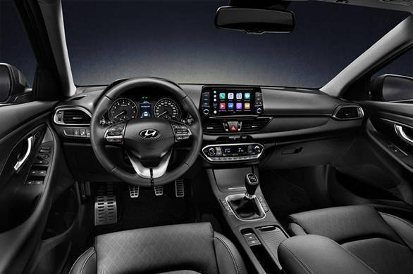 The interior looks smart with thoughtfully laid out switches. The floating, 8-inch touchscreen infotainment system will feature Apple CarPlay and Android Auto. - width=