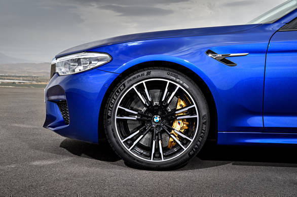 Behind those light-metal cast dual-spoke bicolour wheels are the gold calipers that identify the optional carbon ceramic brakes