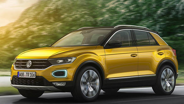 The front of the Volkswagen T-Roc is dominated by a wide grill that converges into the slim LED headlamps