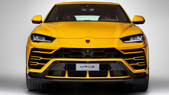 The 2018 Lamborghini Urus production-spec car features an aggressive front with large air scoops