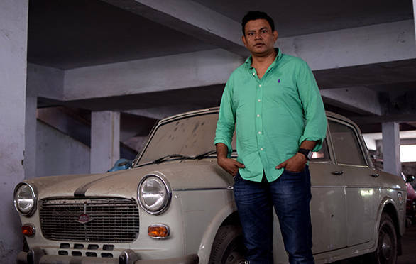 Mohammad Omar and his uncle's 1996 Padmini, now parked in an unlit basement