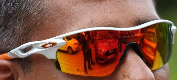 Our cars reflected in the polarised lenses of our Oakleys