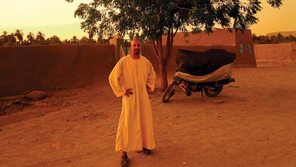 Wearing a Gelabiyya, the clothes of desert men in northern Sudan