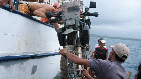 Loading sanDRina onto a ship to cross from Panama to Colombia