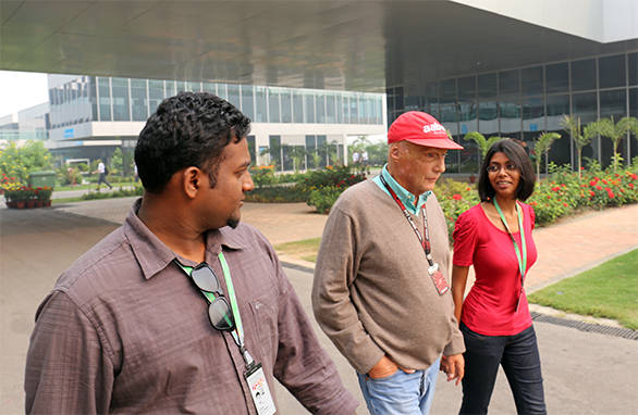 Team OD has a quick chat with Niki Lauda as he strides through the paddock at the BIC