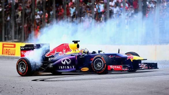 Sebastian Vettel celebrates his ninth consecutive F1 win with donuts at Interlagos