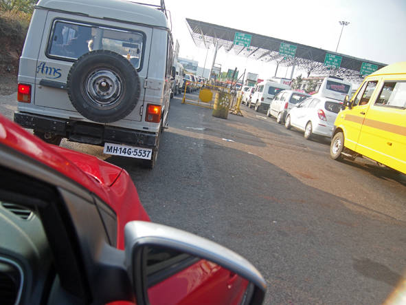 Waiting in line at the Shivapur toll naka