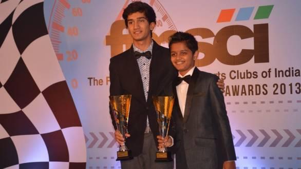Krishnaraj Mahadik and Pradyumna Danigond receiving the awards for their karting title victories