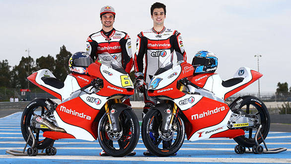 Miguel Oliveira and Arthur Sissis of Mahindra Racing with their bikes