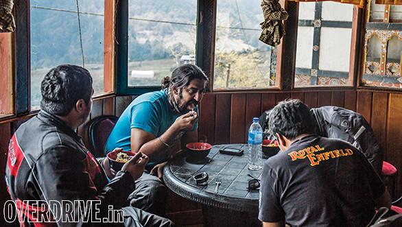Three of us journos scoffing down some double fried pork